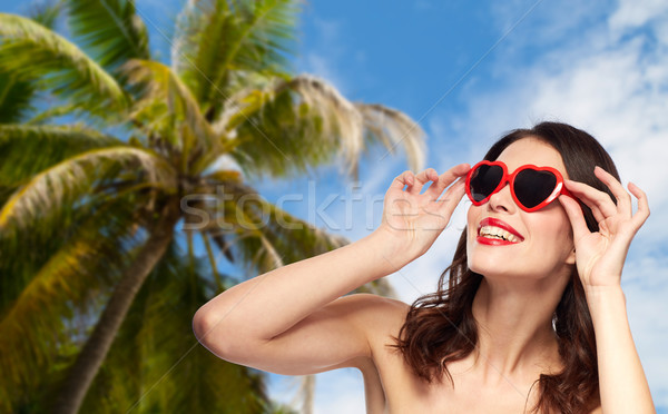 woman with red lipstick and heart shaped shades Stock photo © dolgachov