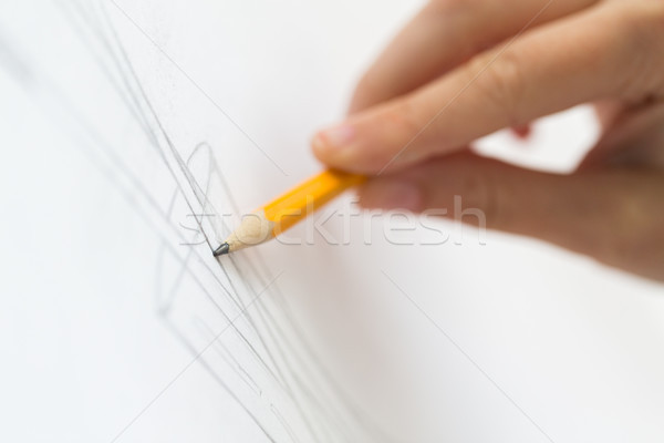 artist with pencil drawing picture at art studio Stock photo © dolgachov