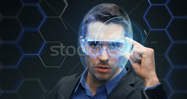 бизнесмен 3d очки виртуальный голограмма будущем технологий Сток-фото © dolgachov