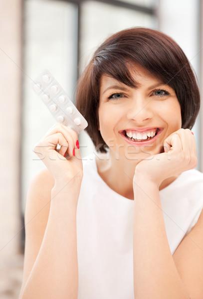 молодые красивая женщина таблетки фотография женщину медицинской Сток-фото © dolgachov