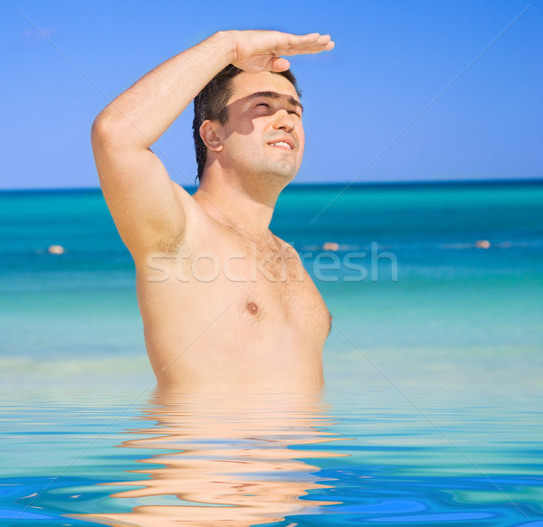 happy tanned man on the beach Stock photo © dolgachov
