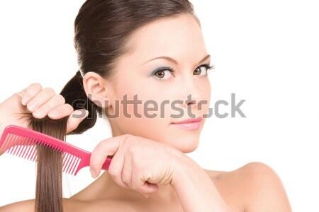 Mulher pente brilhante quadro bela mulher cara Foto stock © dolgachov
