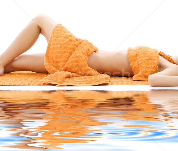 torso of relaxed lady with orange towels Stock photo © dolgachov
