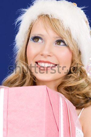 santa helper girl with gift box and christmas tree Stock photo © dolgachov