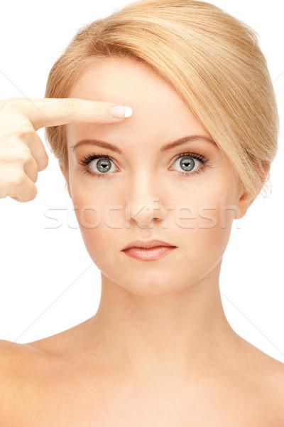 Belle femme pointant front photos femme mains Photo stock © dolgachov