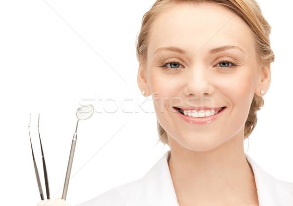 Привлекательная женщина стоматолога инструменты фотография женщину девушки Сток-фото © dolgachov