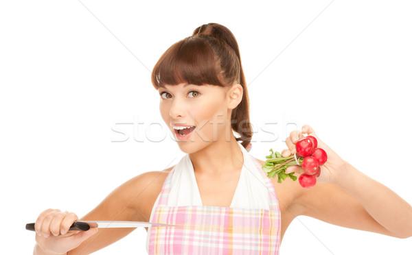 housewife with big knife and radish Stock photo © dolgachov