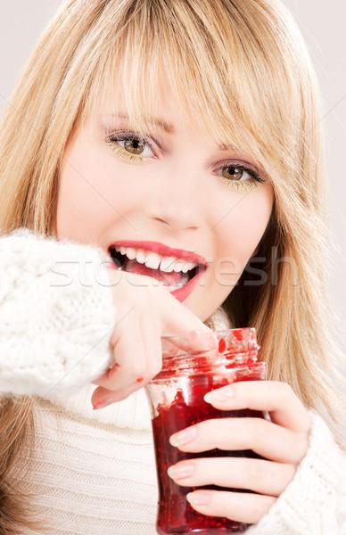 happy teenage girl with raspberry jam Stock photo © dolgachov