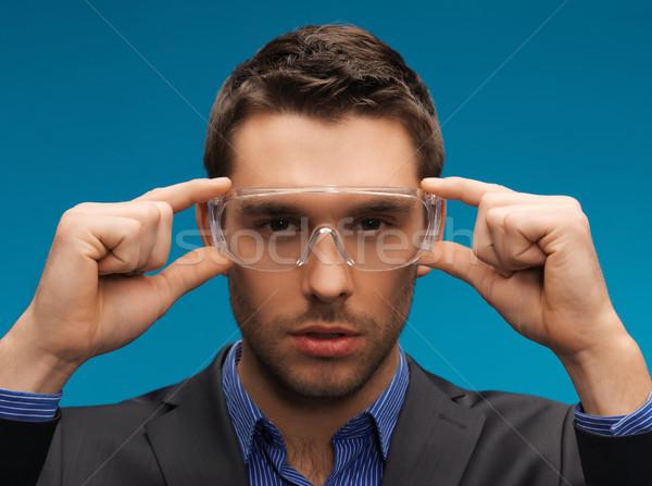businessman in protective glasses Stock photo © dolgachov