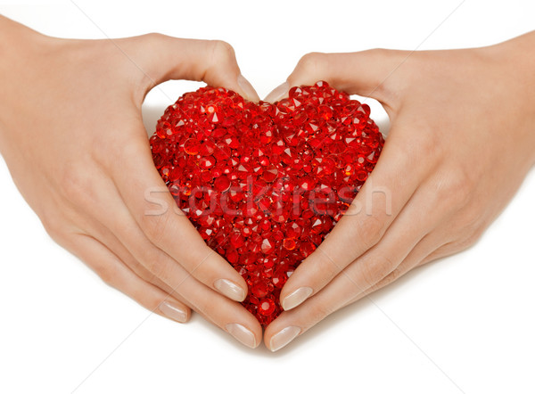 Kadın eller kalp parlak Stok fotoğraf © dolgachov