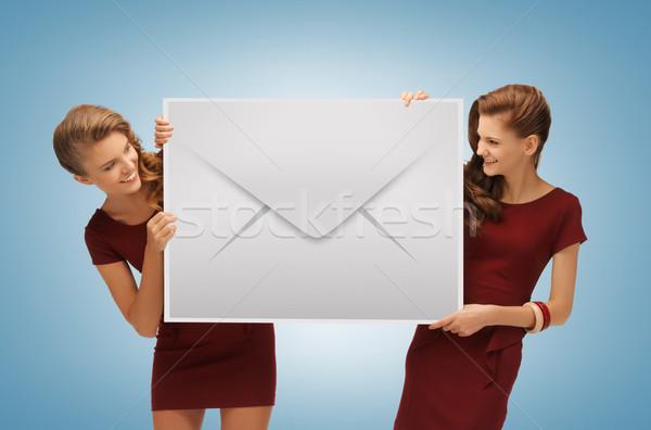 girls holding big envelope Stock photo © dolgachov