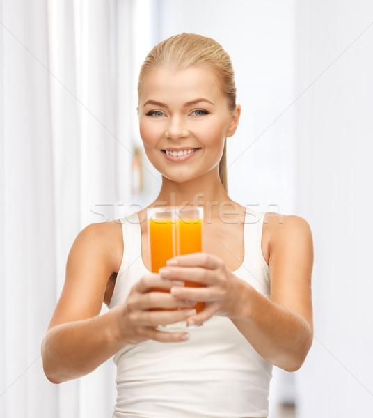 Vrouw glas sinaasappelsap jonge vrouw gelukkig Stockfoto © dolgachov