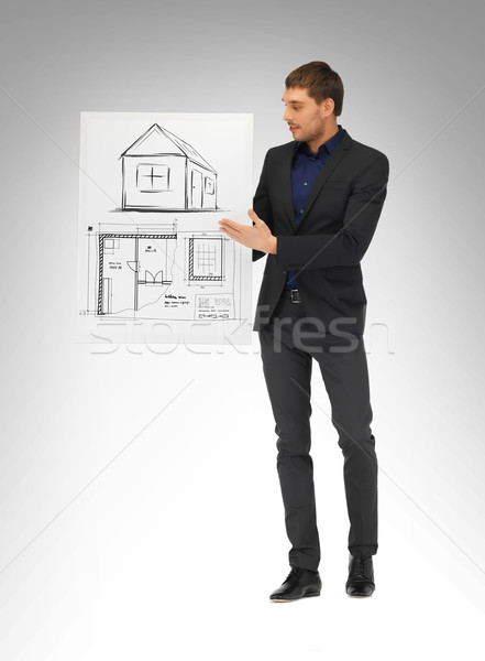 man holding picture with house Stock photo © dolgachov