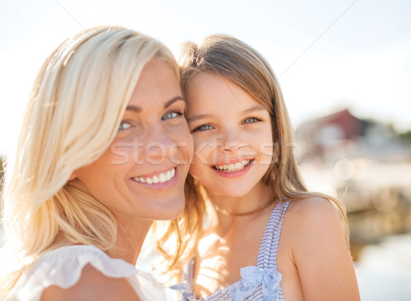 happy mother and child girl Stock photo © dolgachov