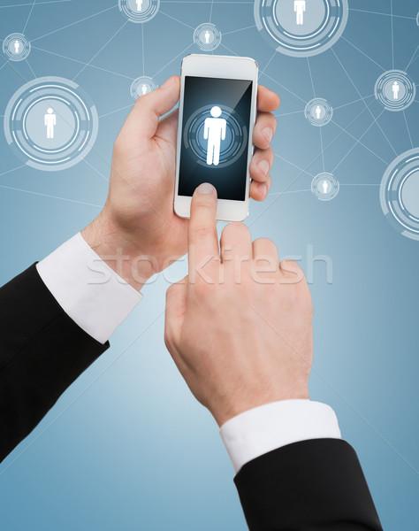 Işadamı dokunmak ekran iş Internet Stok fotoğraf © dolgachov