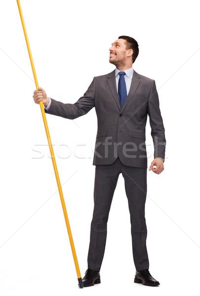 Glimlachend man vlaggestok denkbeeldig vlag Stockfoto © dolgachov