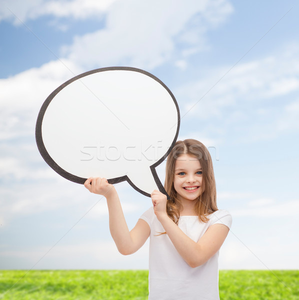 smiling little girl with blank text bubble Stock photo © dolgachov