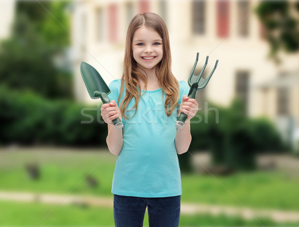 Stock photo: smiling little girl with rake and scoop