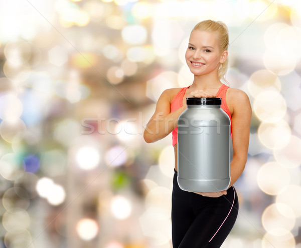 Sorridere donna jar proteine fitness Foto d'archivio © dolgachov