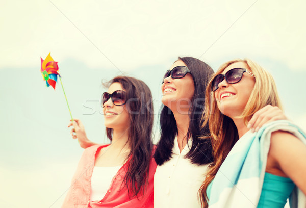 smiling girls in shades having fun on the beach Stock photo © dolgachov
