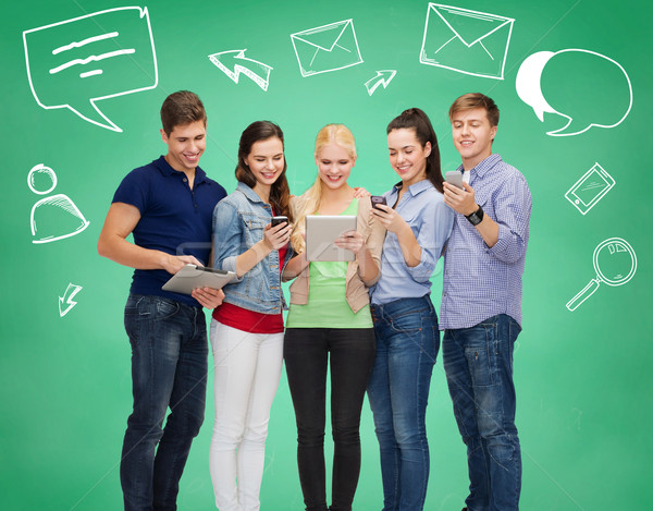 smiling students with tablet pcs and smartphones Stock photo © dolgachov