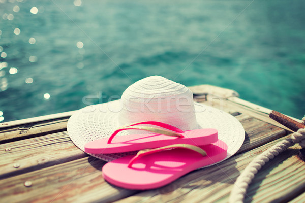 close up of hat and slippers at seaside Stock photo © dolgachov