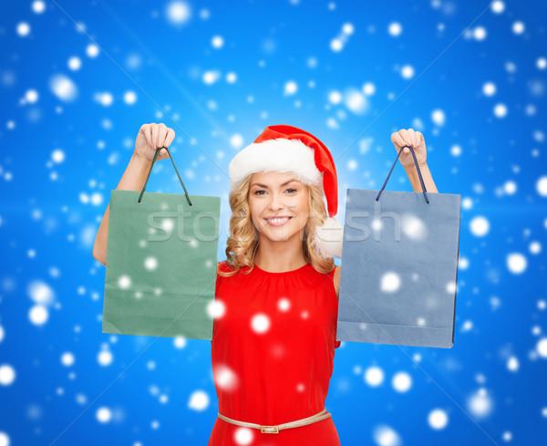 女性 サンタクロース ヘルパー 帽子 ショッピングバッグ 販売 ストックフォト © dolgachov