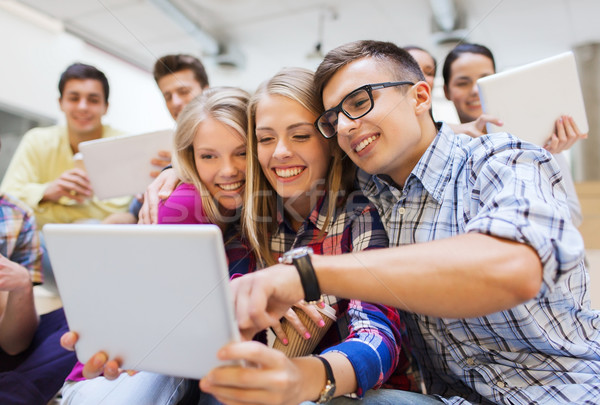 Stock photo: group of smiling students with tablet pc
