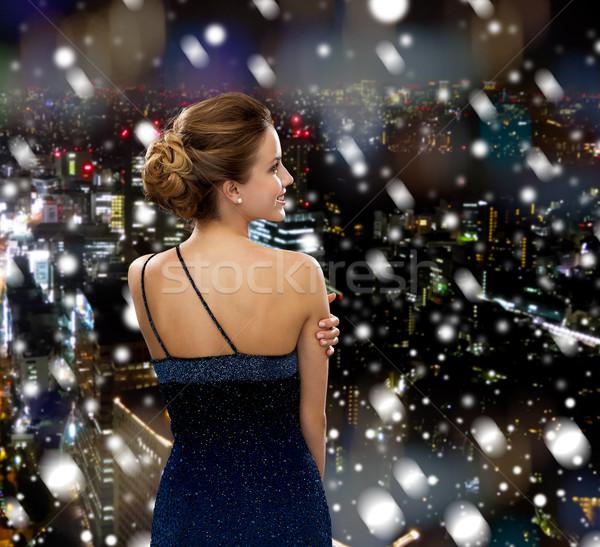 Glimlachende vrouw avondkleding mensen vakantie christmas nacht Stockfoto © dolgachov