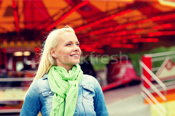 smiling young woman in amusement park Stock photo © dolgachov