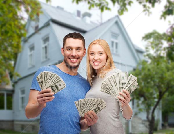 Stock fotó: Mosolyog · pár · mutat · pénz · ház · szeretet