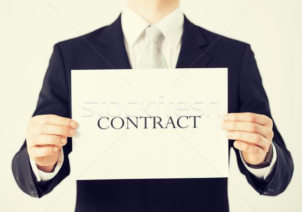 Man handen contract papier foto Stockfoto © dolgachov