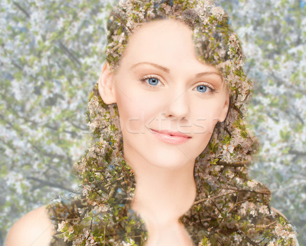 happy young woman over blooming tree pattern Stock photo © dolgachov
