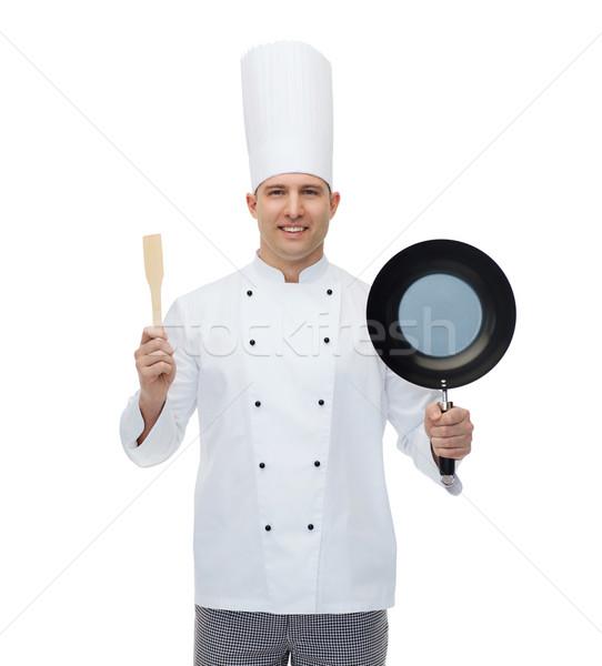 Fericit masculin bucătar-şef tigaie Imagine de stoc © dolgachov
