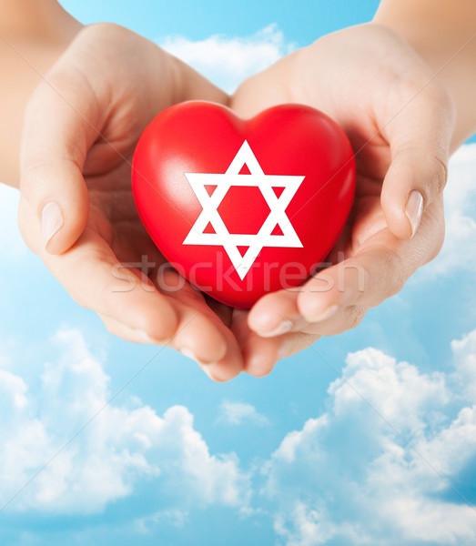 close up of hands holding heart with jewish star Stock photo © dolgachov