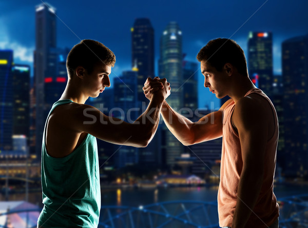 Stock photo: two young men arm wrestling