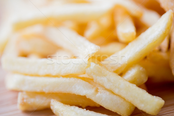 close up of french fries on table Stock photo © dolgachov