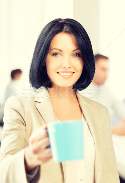 beautiful businesswoman with cup of coffee Stock photo © dolgachov
