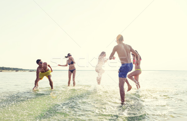 Stock photo: happy friends having fun on summer beach
