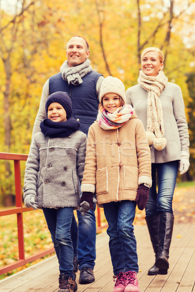 happy family in autumn park Stock photo © dolgachov