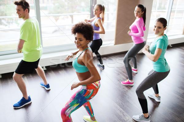 группа улыбаясь люди танцы спортзал студию Сток-фото © dolgachov