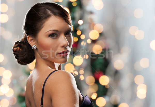 Mujer diamantes pendiente Navidad luces personas Foto stock © dolgachov