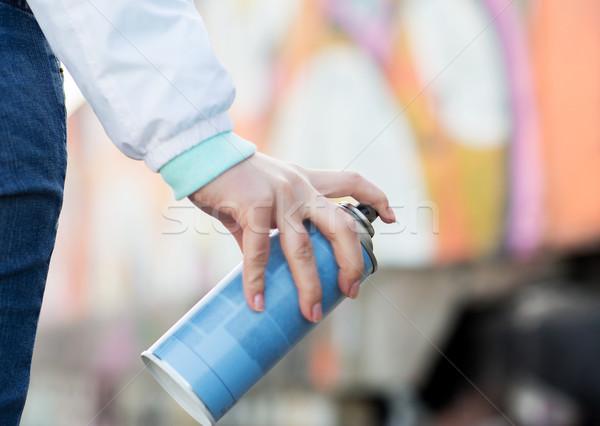 Mano pintura en aerosol graffiti personas Foto stock © dolgachov