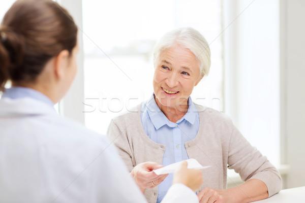 doctor giving prescription to senior woman Stock photo © dolgachov