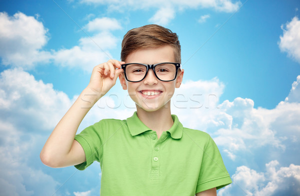 happy boy in green polo t-shirt and eyeglasses Stock photo © dolgachov