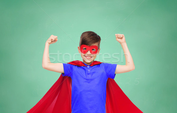 boy in red super hero cape and mask showing fists Stock photo © dolgachov
