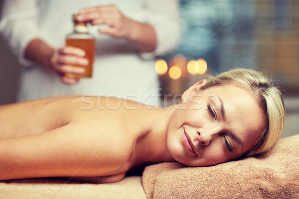 close up of woman lying on massage table in spa Stock photo © dolgachov