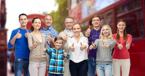 group of people showing thumbs up over london city Stock photo © dolgachov
