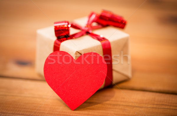 close up of gift box and heart shaped note on wood Stock photo © dolgachov