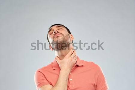 Homem tocante pescoço sofrimento garganta dor Foto stock © dolgachov